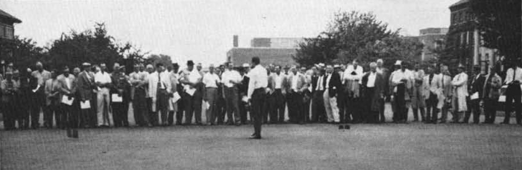 Group of People standing on putting green on Purdue University Campus in 1958